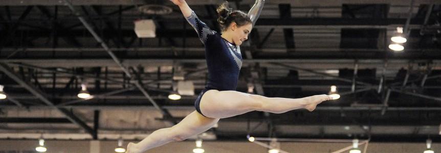 gymnastist doing split in the air