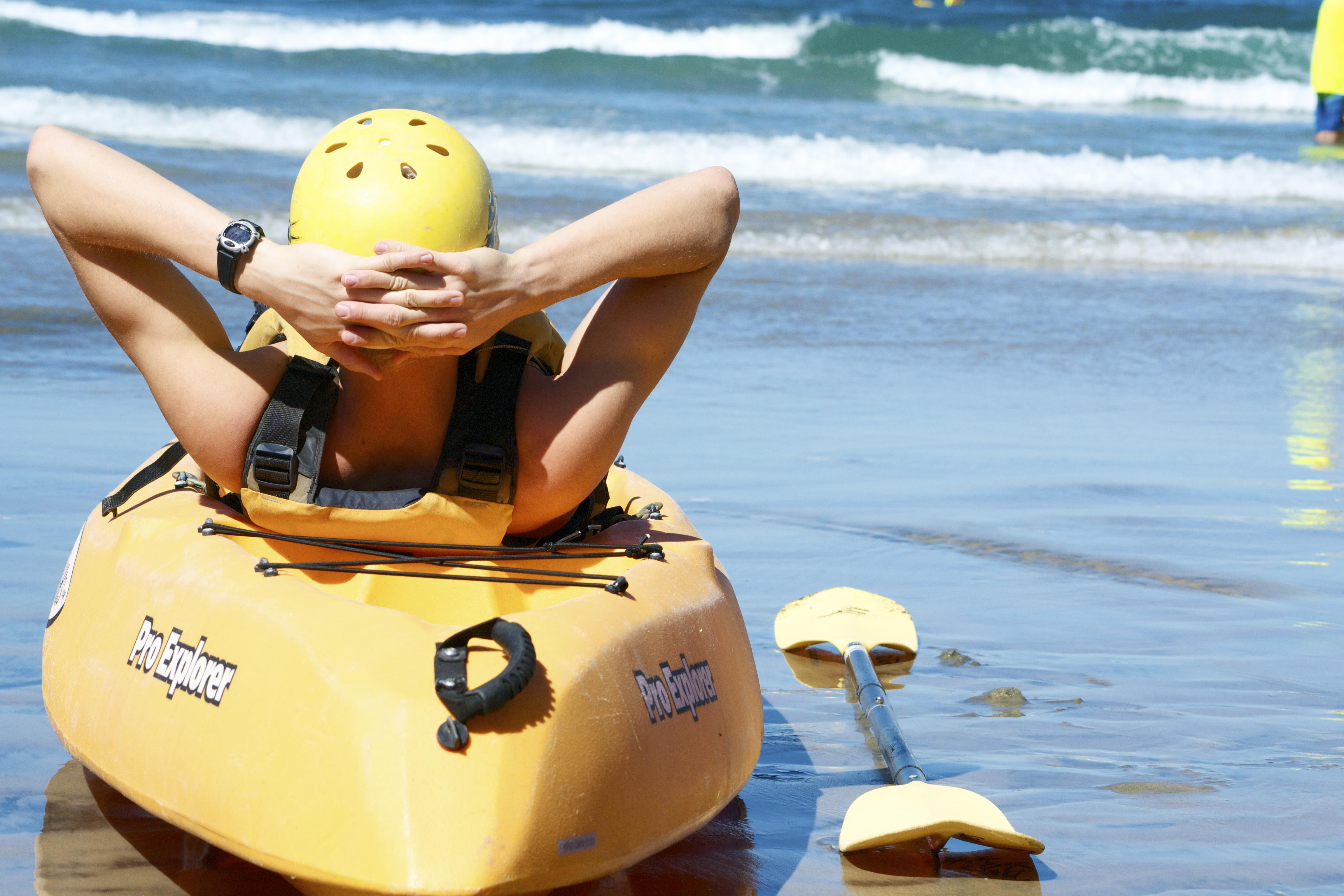 lying on a kayak